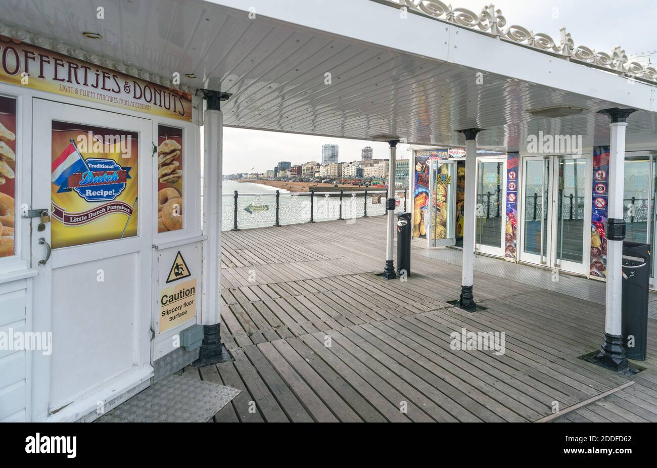 At the iconic Brighton Pier during the winter low season,visitors are few compared to the busy summer months,but it still retains it's allure for pote Stock Photo