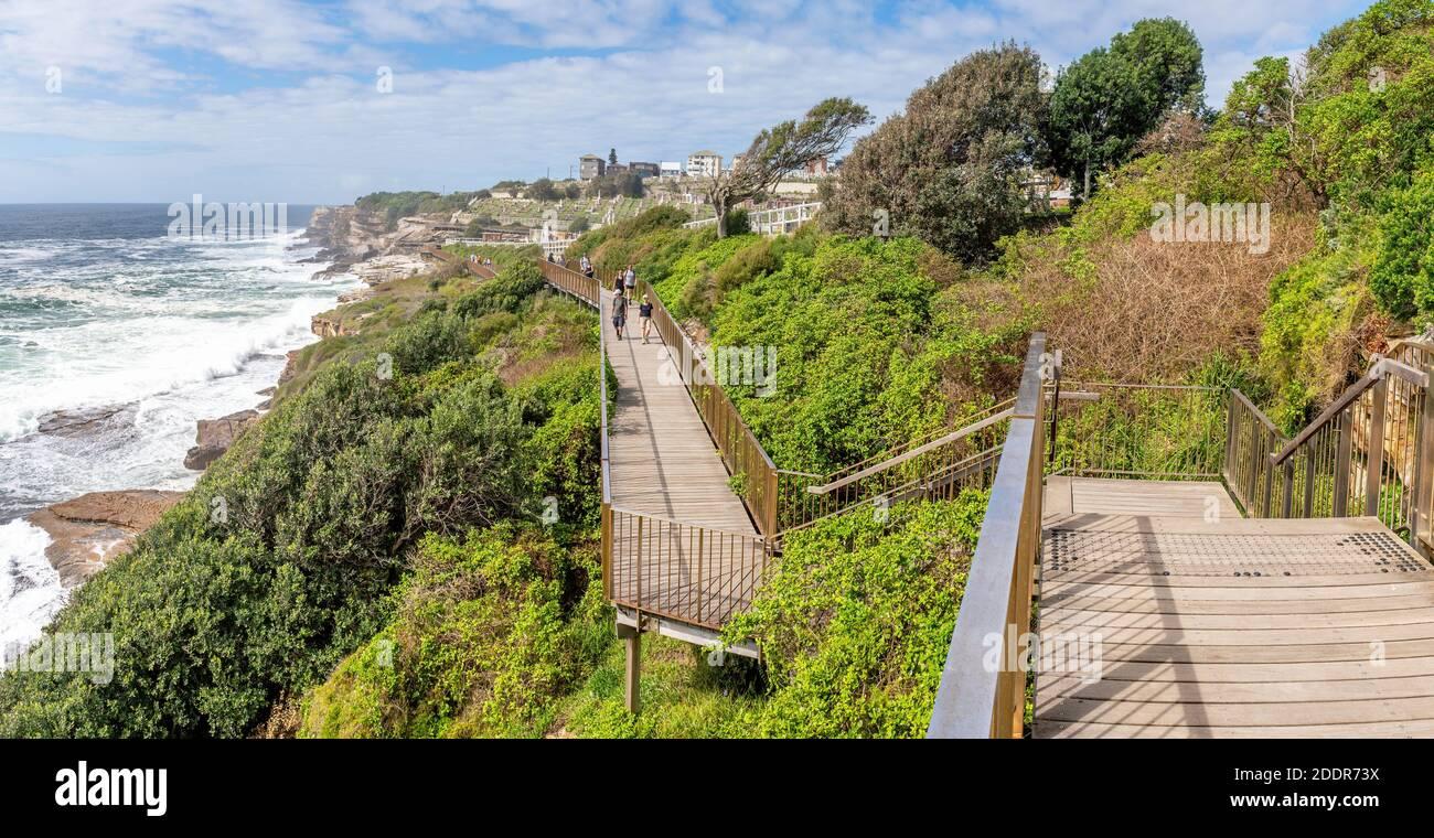 Sydney, Australia - People walking on the Coogee to Bondi coastal walk. This famous coastal walk extends for six km in Sydney's eastern suburbs. Stock Photo