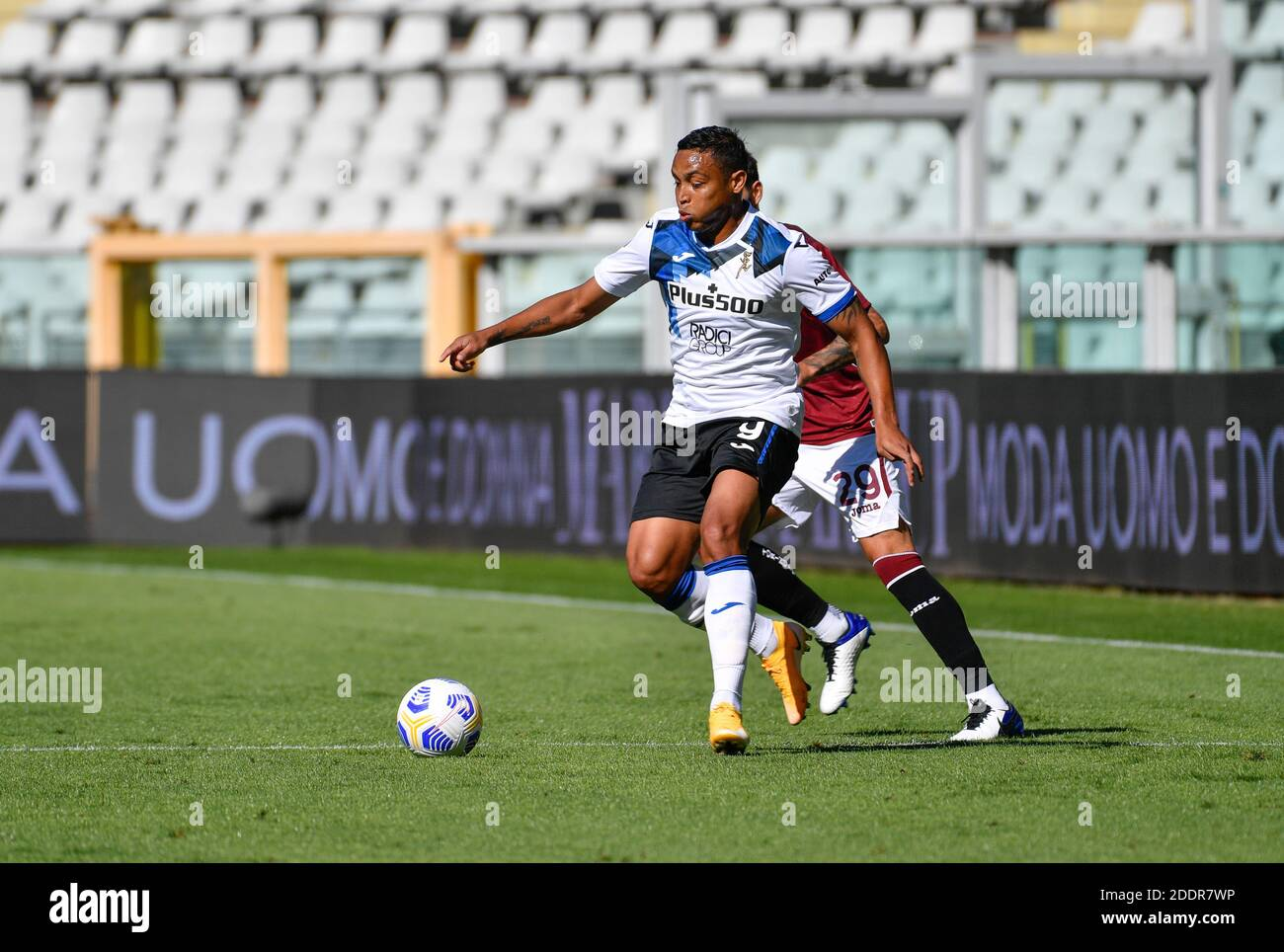 Torino, Italy. 26th, September 2020. Luis Muriel (9) of Atalanta and Nicola Murru (29) of Torino seen in the Serie A match between Torino and Atalanta at Stadio Olimpico in Torino. (Photo credit: Gonzales Photo - Tommaso Fimiano). Stock Photo