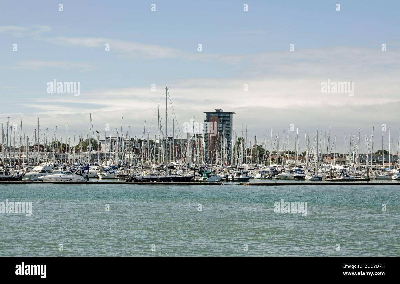 Gosport, UK - September 8, 2020: View across Portsmouth Harbour towards Weevil Lake, Gosport Marina and the new Rope Quays housing development on a su Stock Photo