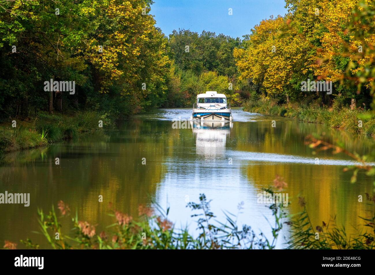 The Canal du Midi, near Carcassonne, French department of Aude, Occitanie Region, Languedoc-Rousillon France. Boats moored on the tree lined canal.  T Stock Photo