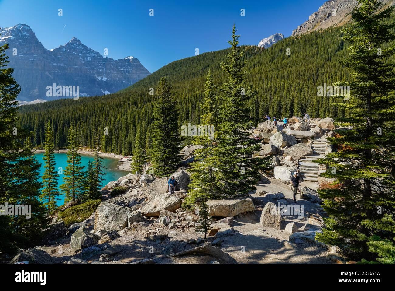 Moraine Lake Rockpile Trail in summer sunny day morning, Tourists enjoying the beautiful scenery. Banff National Park, Canadian Rockies, Alberta Stock Photo