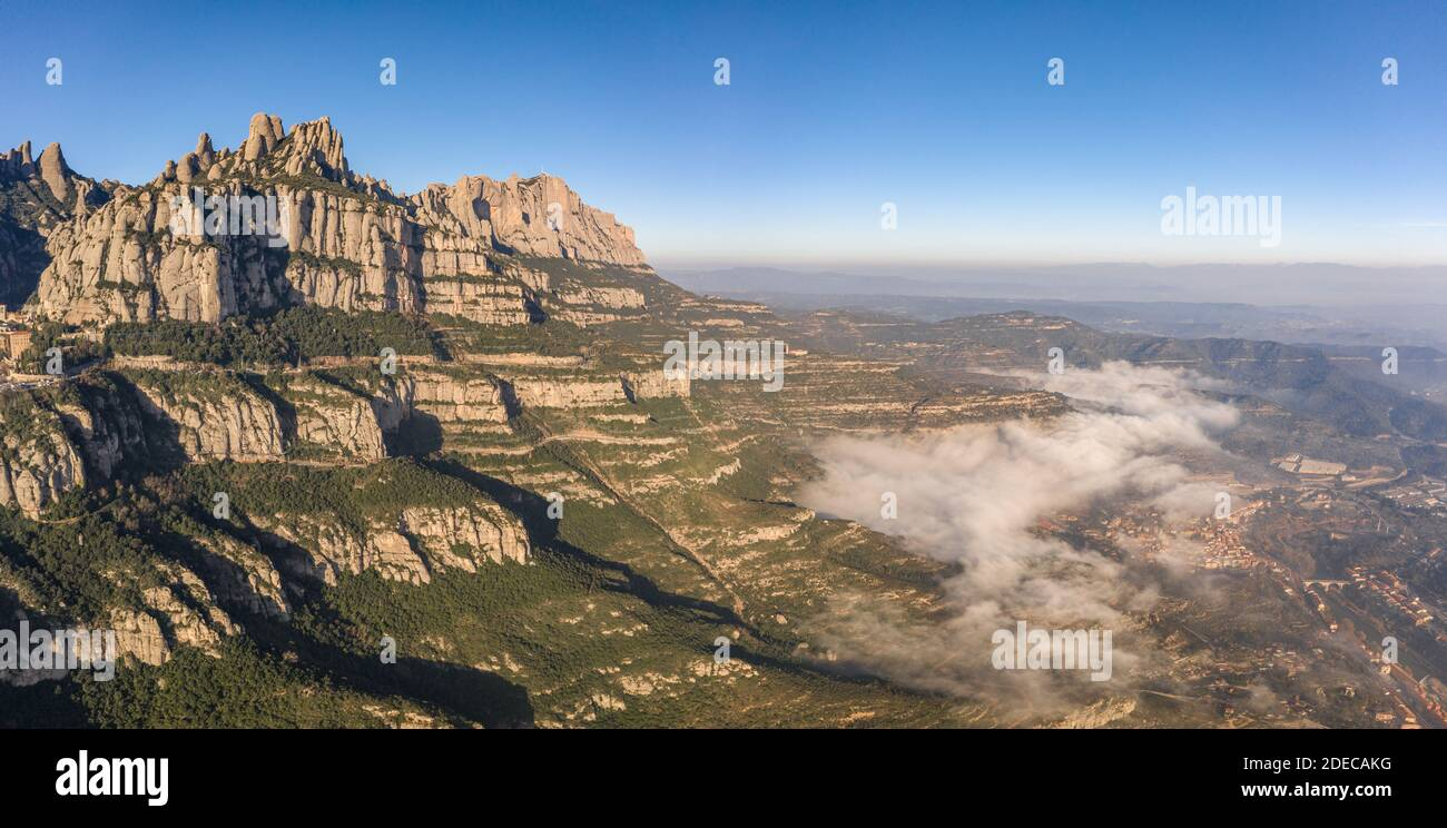 Panoramic aerial drone view of Montserrat mountain range and its valley near Barcelona Stock Photo