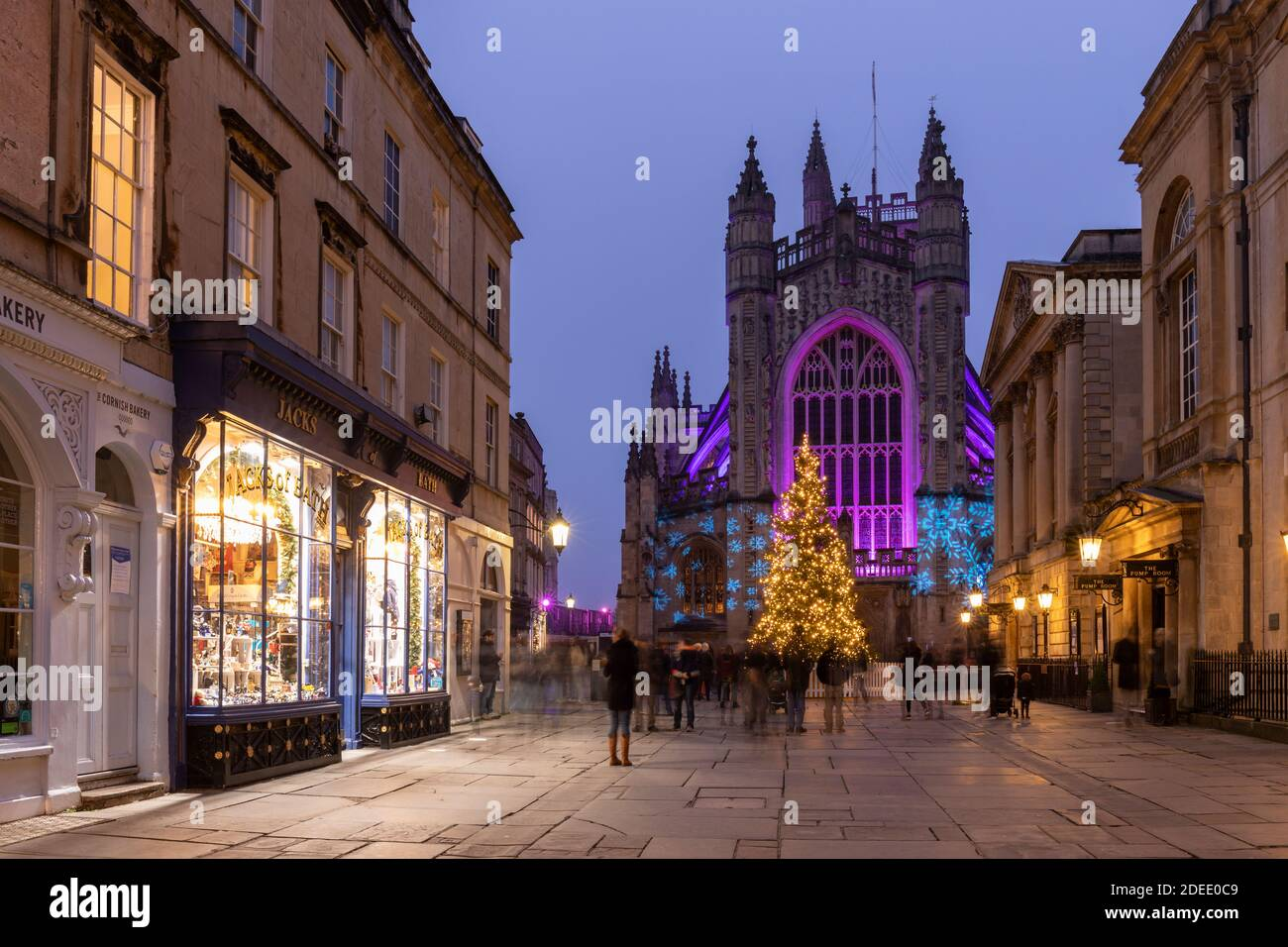 Bath Abbey lit with colourful illuminations and a bright tall Christmas tree. Part of the 2020 Christmas Light Trail in Bath City Centre, England, UK Stock Photo