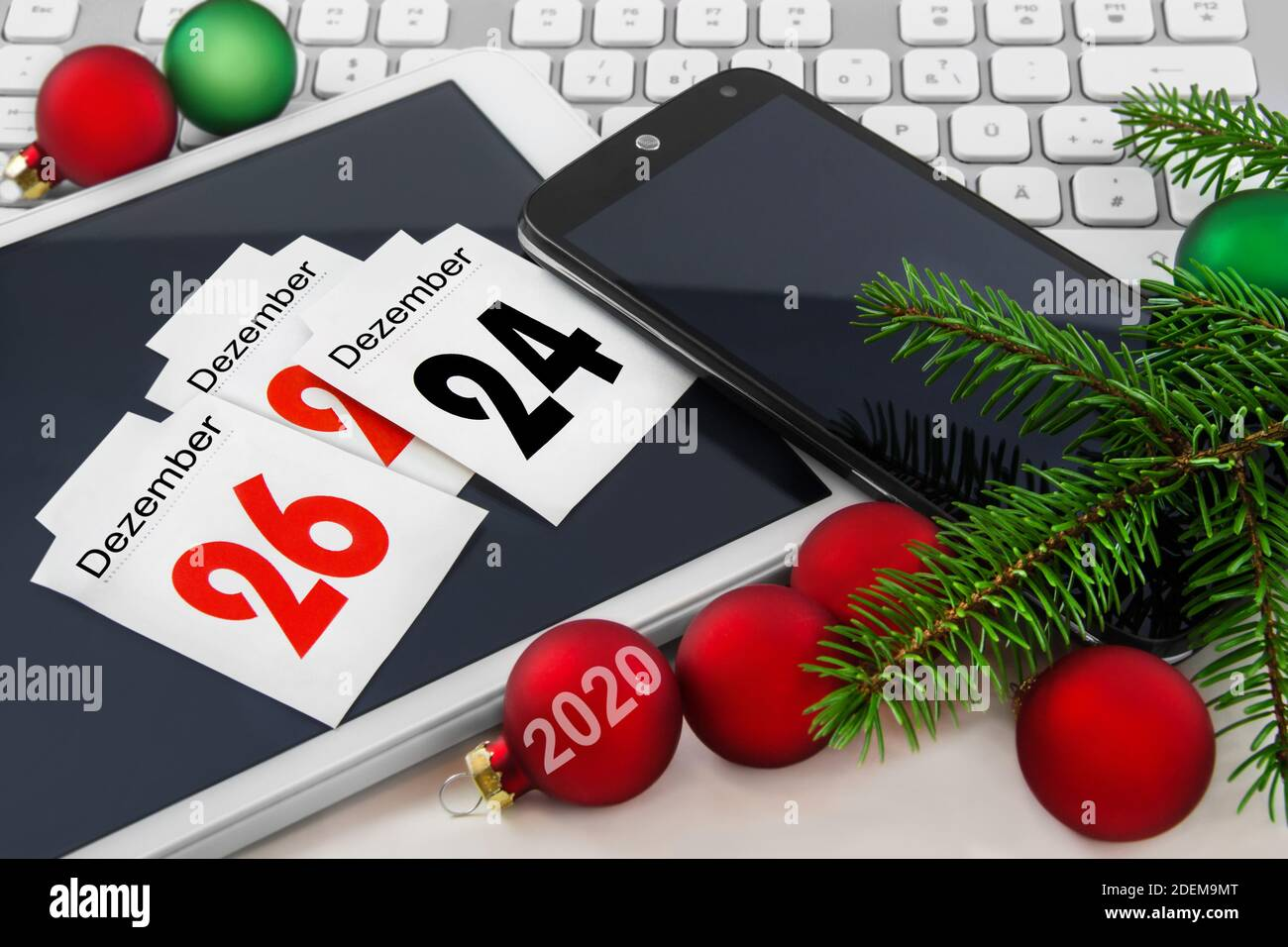 Chistmas time decoration with mobile, tablet and PC Stock Photo