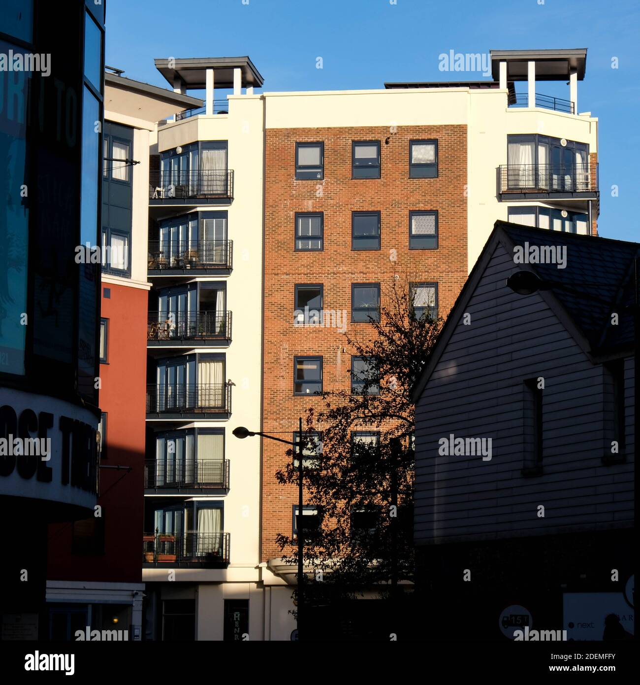 London UK, December 01 2020, New Residential Apartment Building Against A Clear Blue Sky Caught In Mornig Sunlight Stock Photo