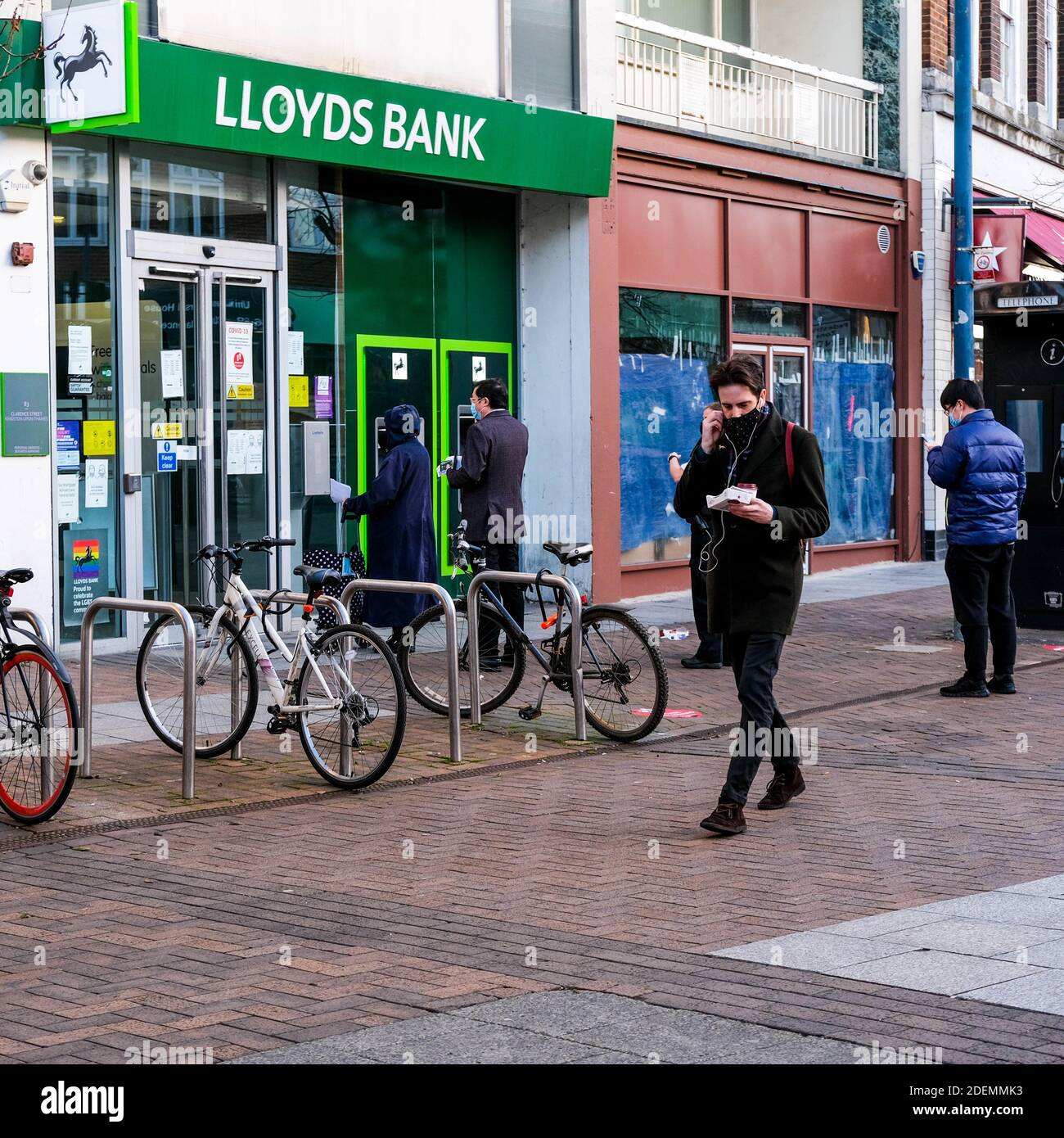 London UK, December 01 2020, Customers Using A Lloyd Bank ATM To Withdraw Money Stock Photo