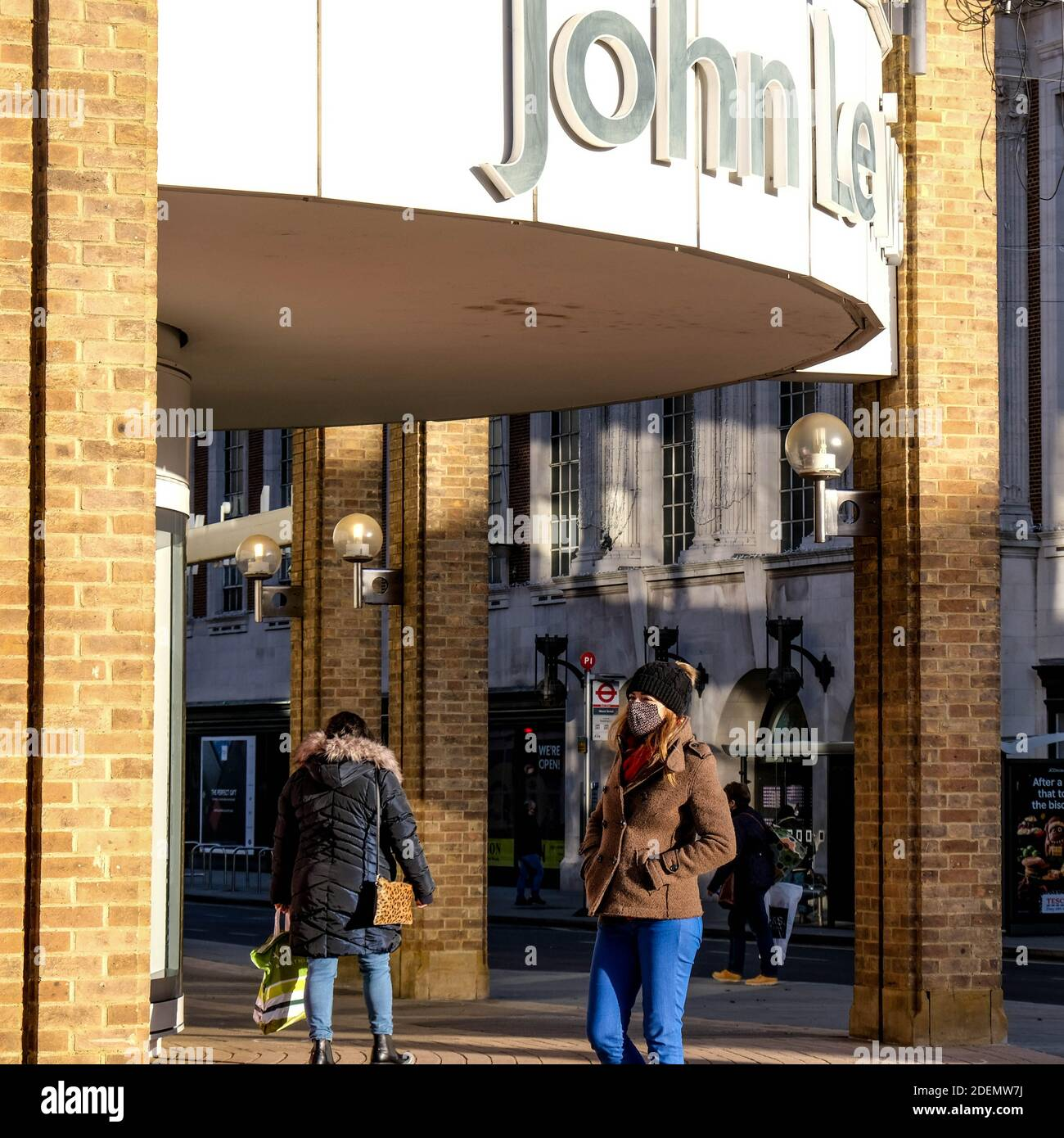 London UK, December 01 2020, People Standing Outside A Large John Lewis Department Store Stock Photo
