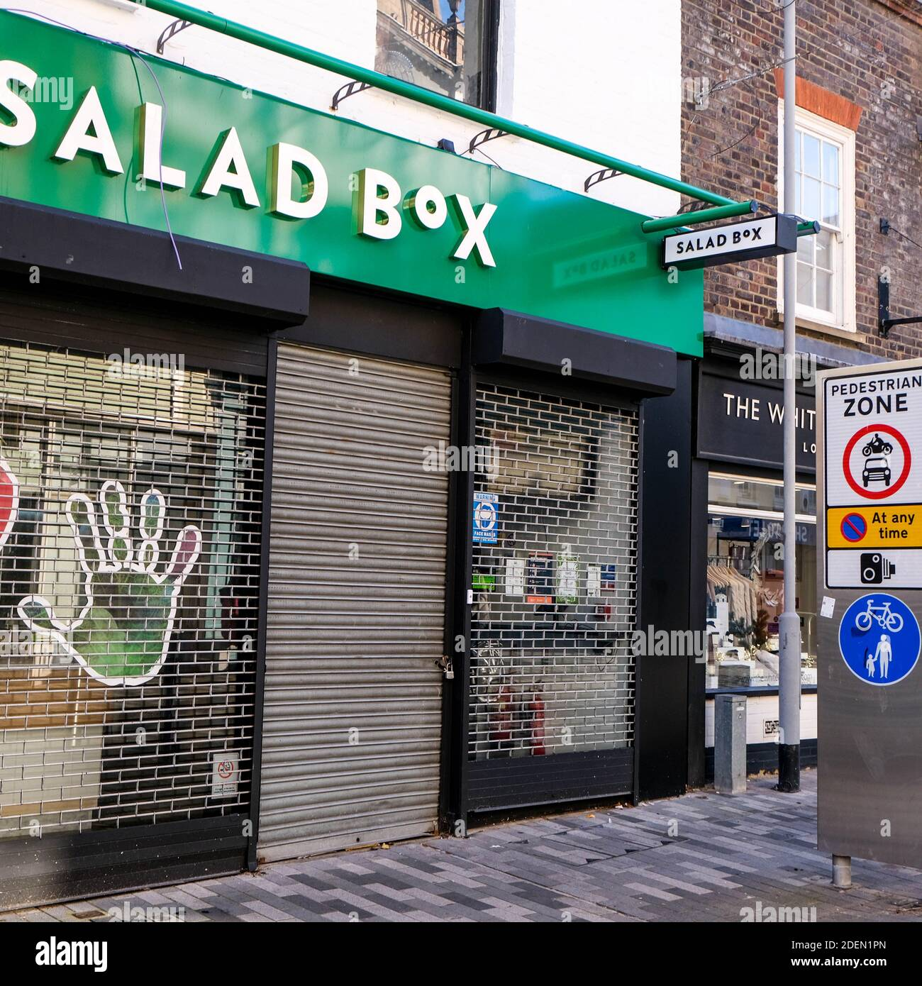 London UK, December 01 2020, Salad Box Vegetarian Restaurant With Security Shutters Down During COVID-19 Lockdown And No People Stock Photo