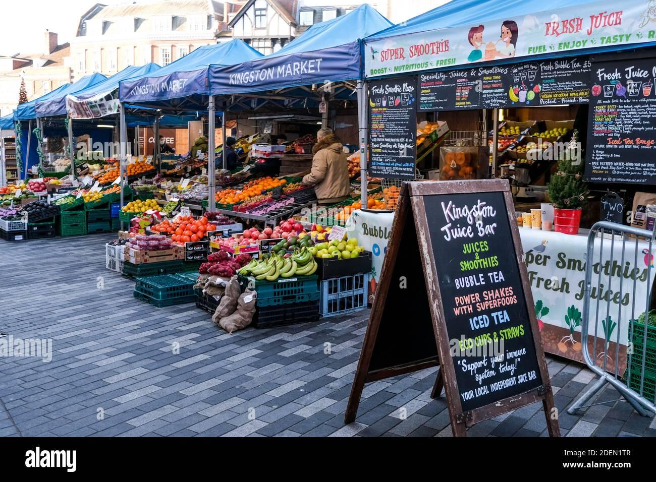 London UK, December 01 2020, Market Traders Selling Fresh Fruit And Vegetables During COVID-19 Lockdown Stock Photo