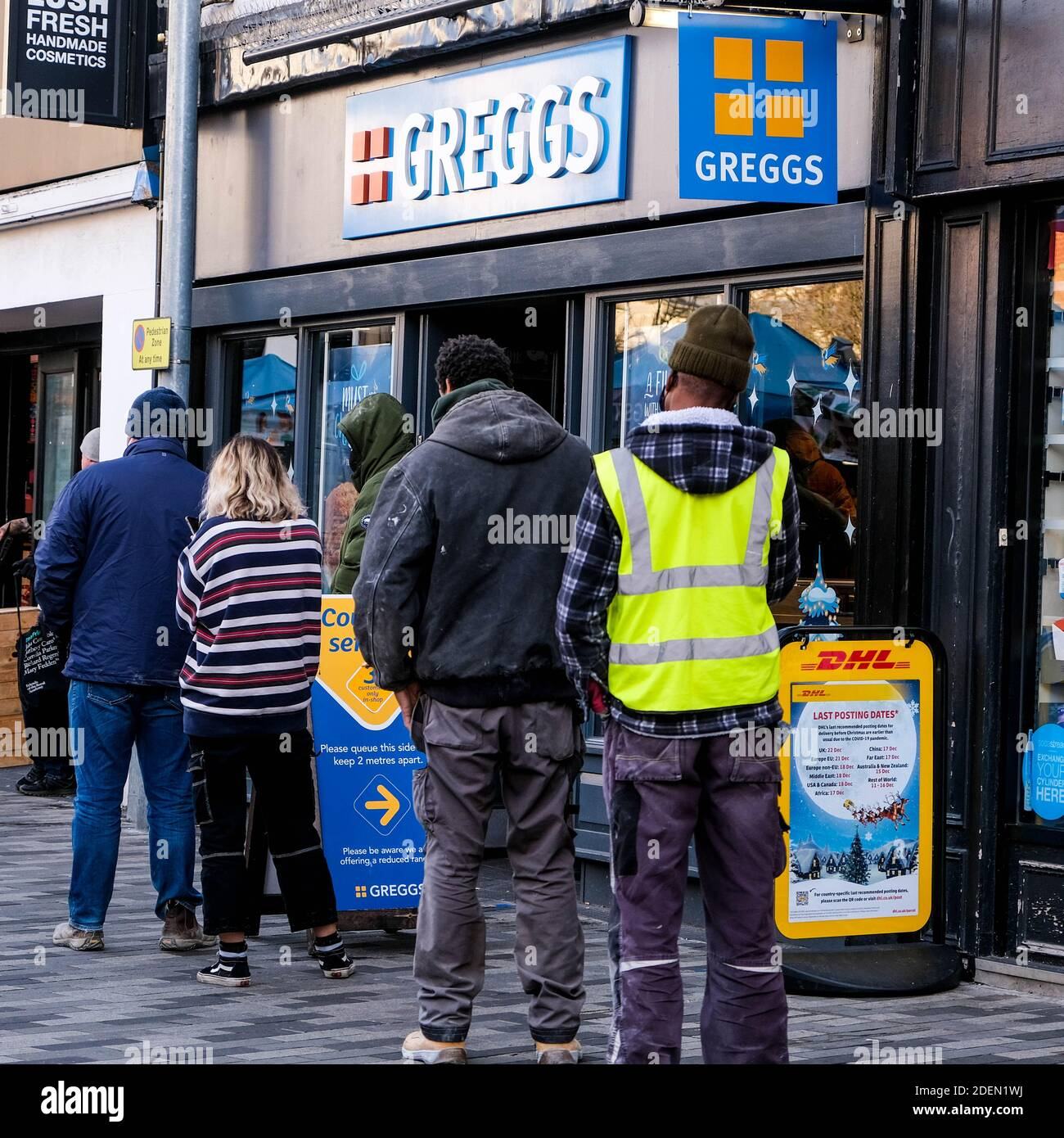 London UK, December 01 2020, Group Of People Customers Queuing Outside Greggs Bakery For Takeaway Food Stock Photo