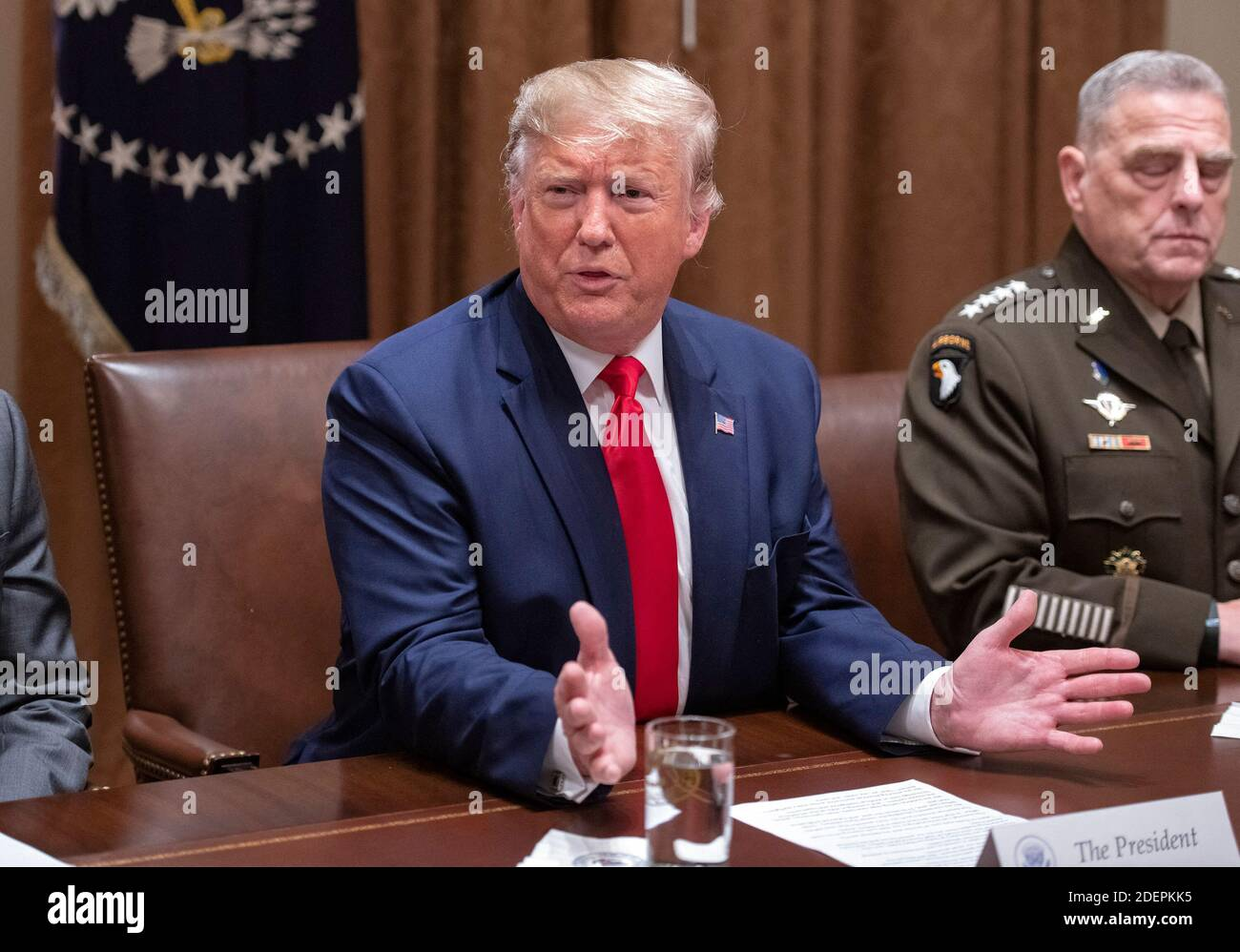 United States President Donald J. Trump answers a reporter's question as he participates in a briefing with senior military leaders in the Cabinet Room of the White House in Washington, DC, USA on Monday, October 7, 2019. At right is United States Army General Mark A. Milley, Chairman of the Joint Chiefs of Staff. Photo by Ron Sachs/CNP/ABACAPRESS.COM Stock Photo