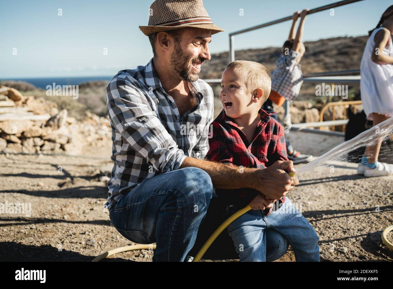 Happy father and son having fun together at ranch farm - Focus on kid face Stock Photo