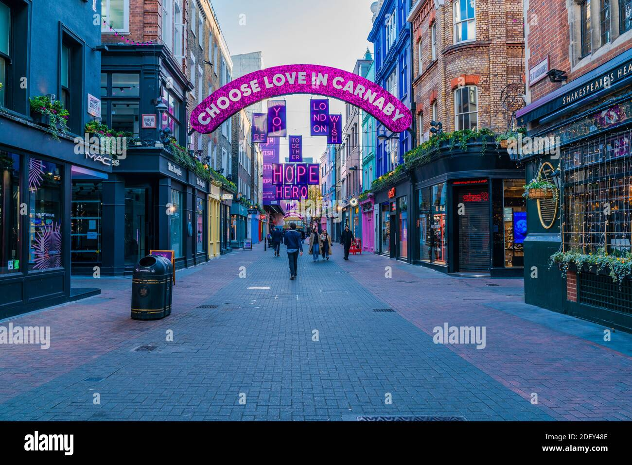 LONDON, UK - DECEMBER 01, 2020 -  This year Carnaby street Christmas decorations, created in collaboration with the Choose Love charity, carry a messa Stock Photo
