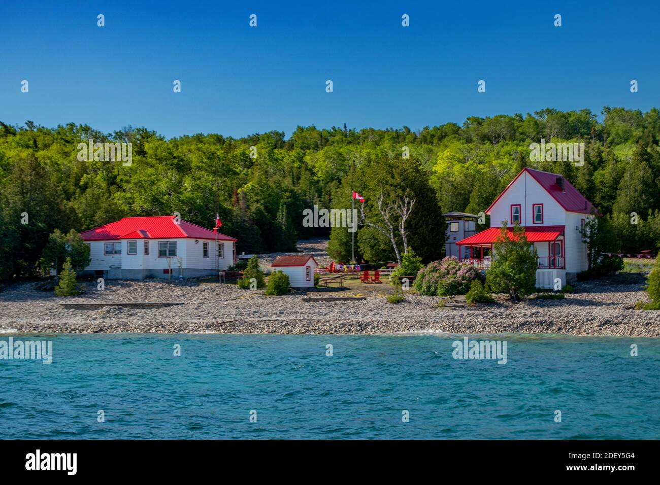 Beautiful cottages seen on an unknown island on Lake Huron, ON. Spectacular scenery in the summer in Georgian Bay in ON, Canada. There are over 30,000 Stock Photo