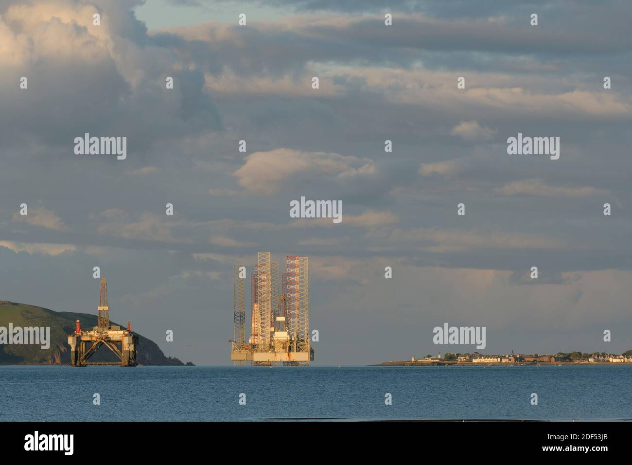 Oil drilling platforms moored in Cromarty Firth, Scotland Stock Photo