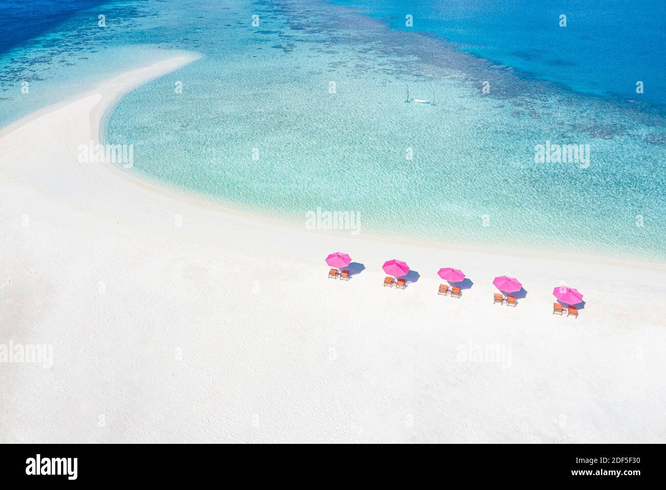 Amazing aerial landscape in Maldives islands. Perfect blue sea and coral reef view from drone or plane. Exotic summer travel and vacation landscape Stock Photo