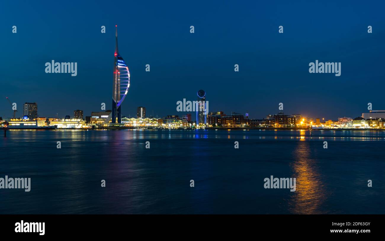 Night time view of Portsmouth and the Emirates Spinnaker Tower from Gosport looking across Portsmouth Harbour in Hampshire, England, UK. Stock Photo