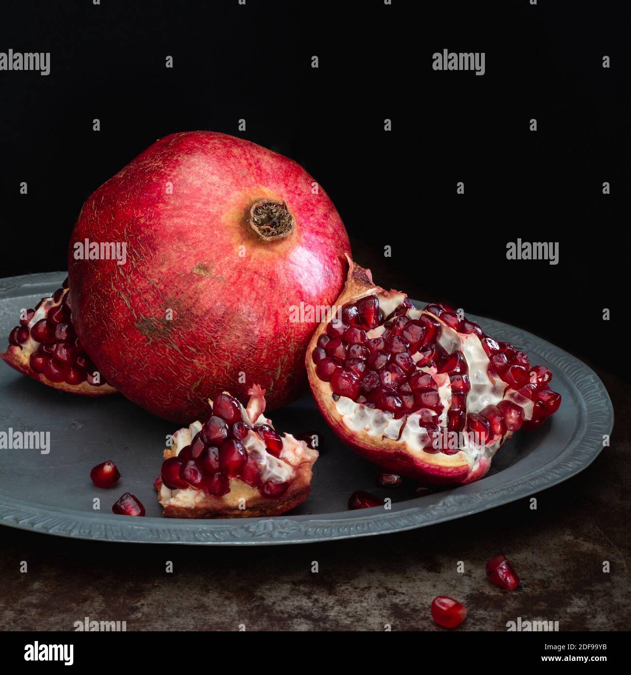 Pomegranate Fruit Whole And Open On A Silver Platter And Black Background Square Stock Photo Alamy