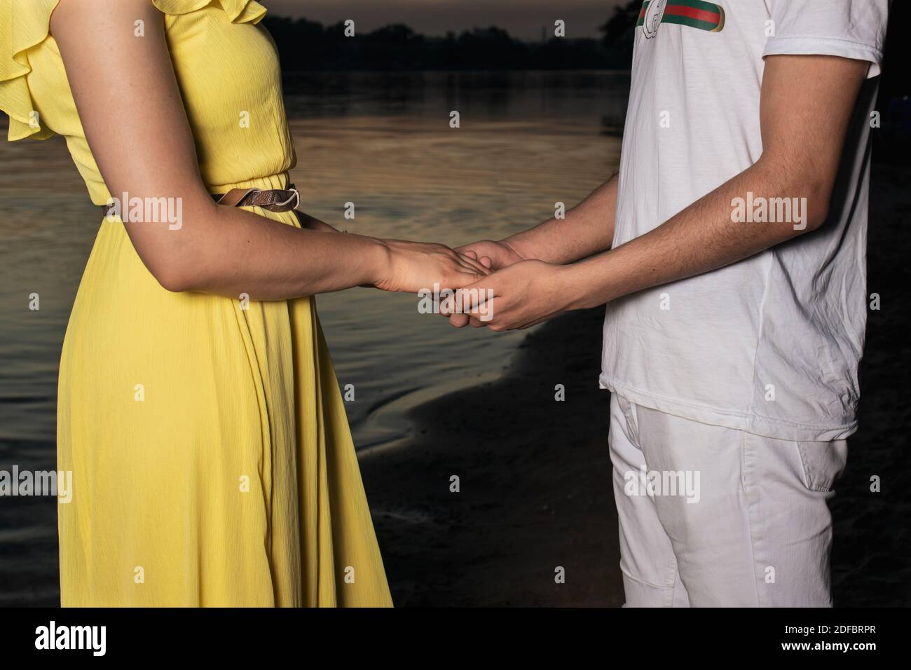 Men's and women's hands of lovers, two men gently hold hands. Love forever, touch and romance Stock Photo