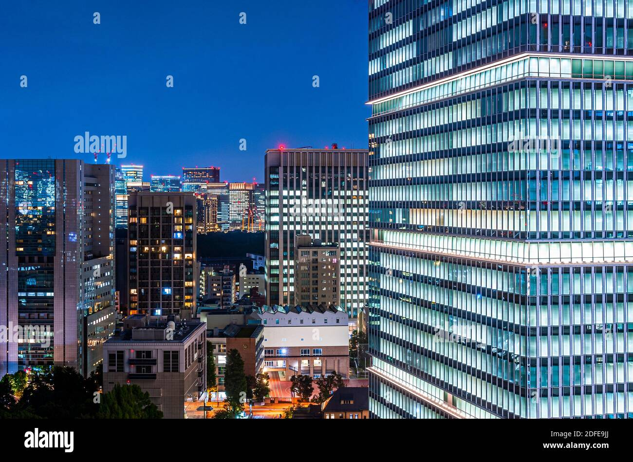 Office Building and Windows Lights at Night Tokyo Japan Stock Photo