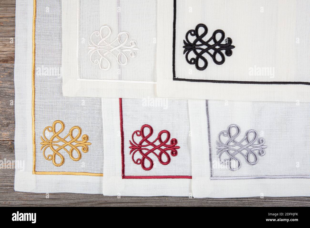 Folded Linen Napkins On Wooden Table Luxury Napkins With Embroidery On The Hem Stock Photo Alamy