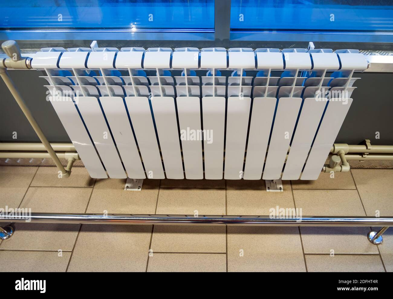 Modern Bimetallic Heating Radiator Installed Under A Window In An Industrial Building Stock Photo Alamy