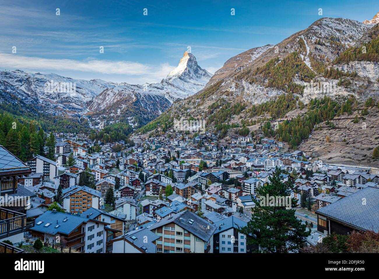 The Swiss village of Zermatt in Valais in autumn at sunrise, with the Matterhorn and the Alpine mountain range in the background. Stock Photo