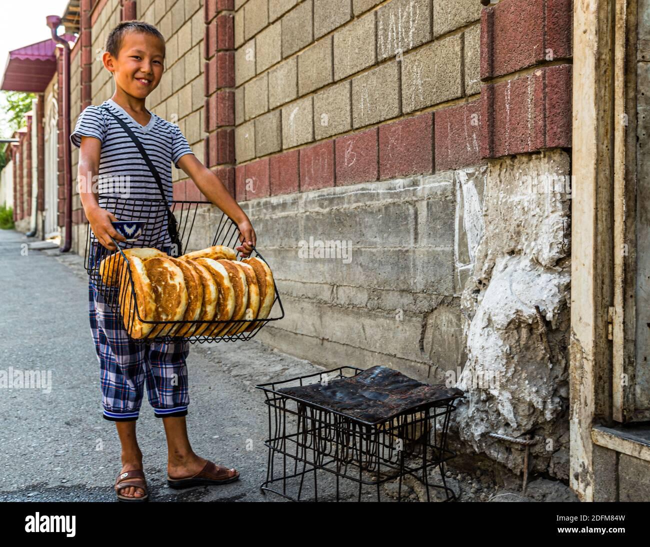Fresh round Bread Tajik Non (Naan). Artisan Bread Bakery in the City of Osh, Kyrgyzstan Stock Photo
