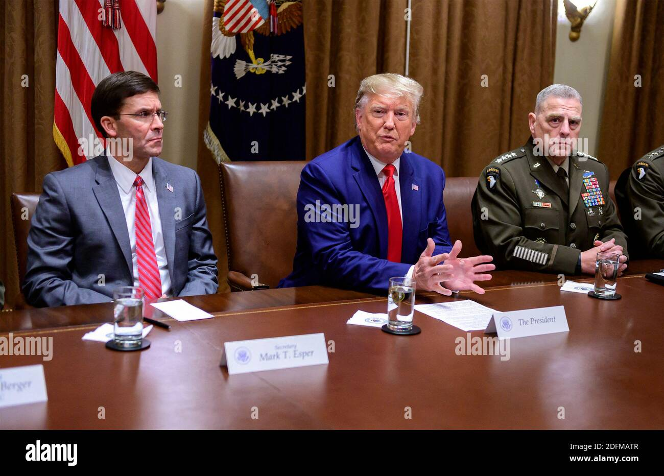 President Donal Trump Dismisses Defence Minister Mark Esper - File -United States President Donald J. Trump answers a reporter's question as he participates in a briefing with senior military leaders in the Cabinet Room of the White House in Washington, DC, USA on Monday, October 7, 2019. At left is United States Secretary of Defense Dr. Mark T. Esper, left, and at right is United States Army General Mark A. Milley, Chairman of the Joint Chiefs of Staff. Photo by Ron Sachs/CNP/ABACAPRESS.COM Stock Photo