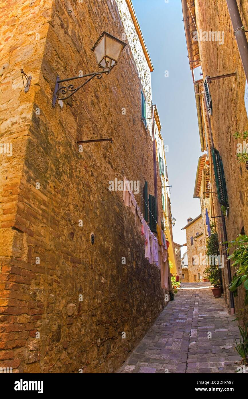 A residential road in the historic medieval village of San Quirico D'Orcia, Siena Province, Tuscany, Italy Stock Photo
