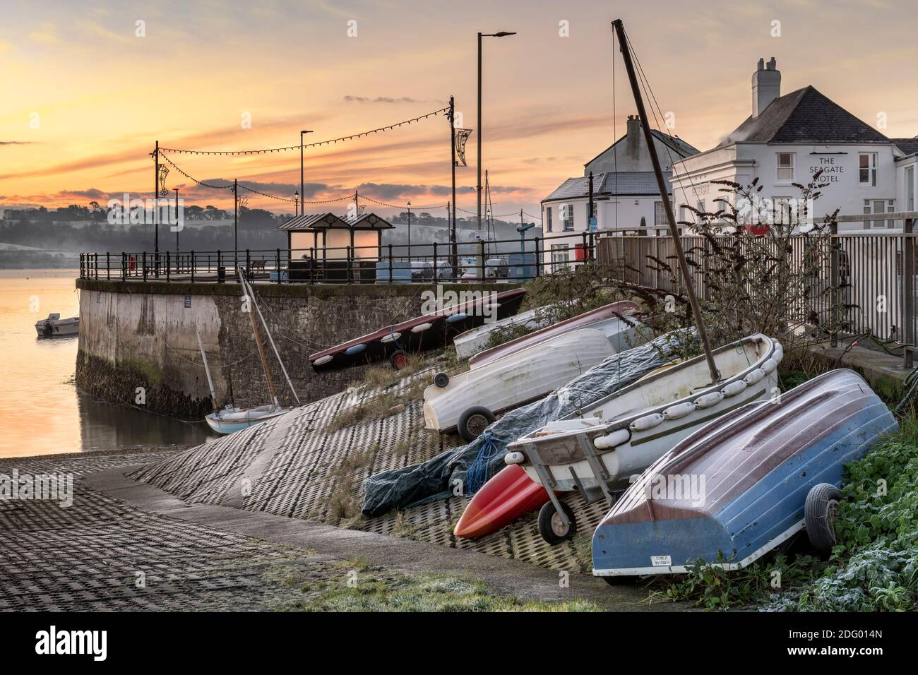 Appledore, North Devon, England. Monday 7th December 2020. UK Weather. After a very cold night in North Devon, a layer of frost covers the small boats tied up along the quay at the coastal village of Appledore. Credit: Terry Mathews/Alamy Live News Stock Photo