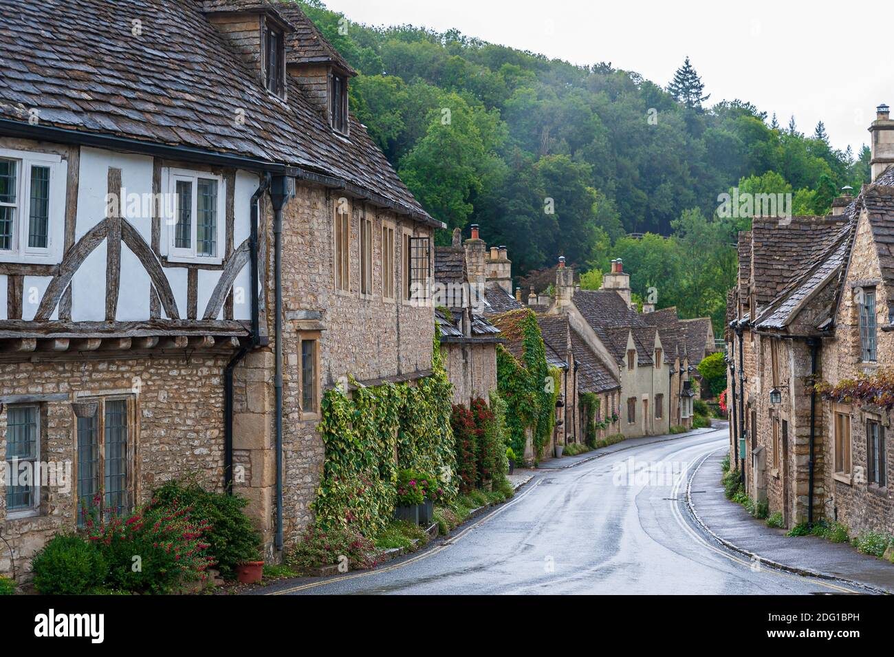Step back in time and visit Castle Combe, quaint village with well preserved masonry houses dated centuries back in Wiltshire in England. Stock Photo