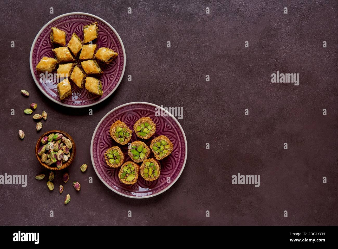 Traditional turkish, arabic sweets baklava assortment with pistachio. Top view, copy space Stock Photo