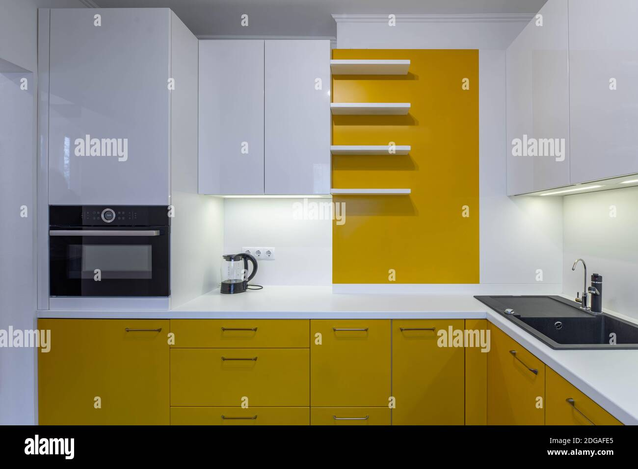 Modern Interior Of Kitchen In Luxury Apartment Yellow Set With White Counter Black Sink Cabinets And Drawers Kettle Oven Stock Photo Alamy