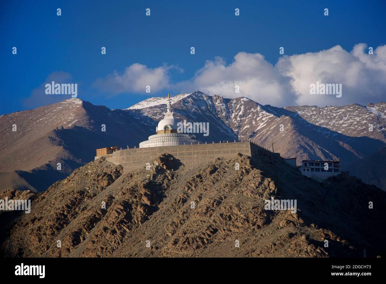 Shanti Stupa - a Buddhist white-domed stupa on a hilltop in Chanspa, Leh district, Ladakh, Jammu and Kashmir, India. Built in 1991 by Japanese Buddhist Bhikshu, Gyomyo Nakamura & part of the Peace Pagoda mission. The Shanti Stupa holds the relics of the Buddha at its base, enshrined by the 14th Dalai Lama. Ladakh, Stock Photo