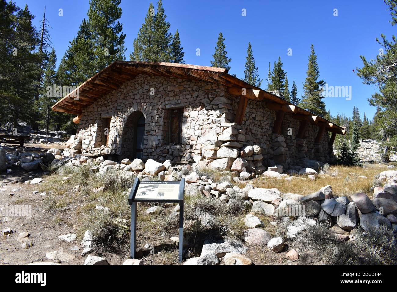 Parsons Lodge, A stone and wooden hut structure in Tuolumne Meadows, Yosemite National Park, USA. A sign with information for visitors stands outside. Stock Photo