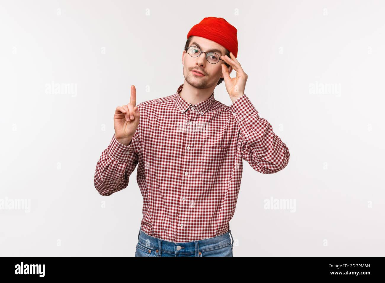 Waist-up portrait of smart and snobbish man patronising someone, scolding someone or correct person, raise one finger adding his Stock Photo