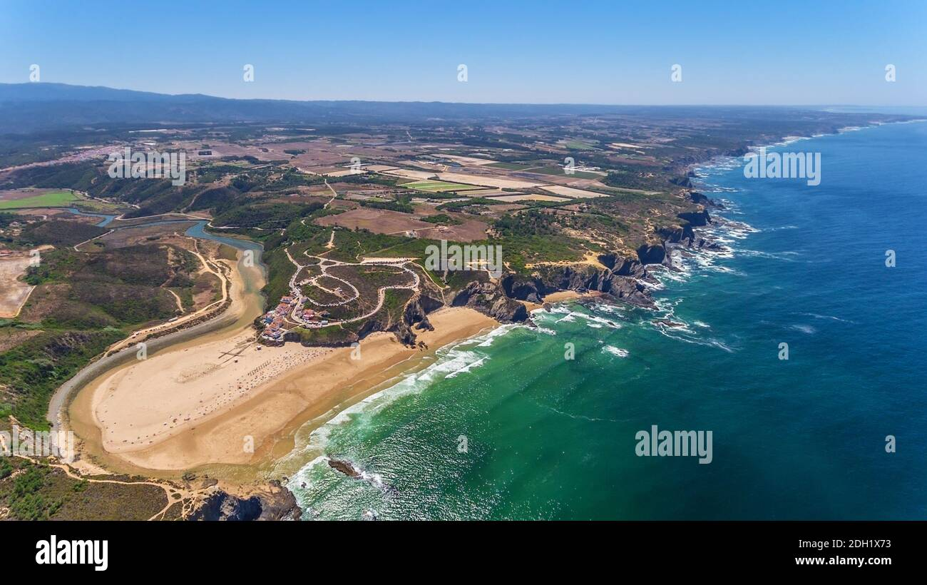 Aerial panorama of the village and Odeceixe beach, in summer overlooking the Algarve. Portugal  Stock Photo