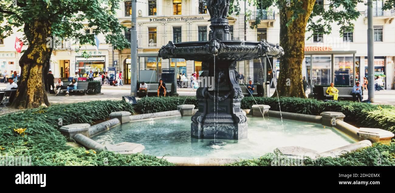 European architecture and fountain in city park in Zurich, Switzerland Stock Photo