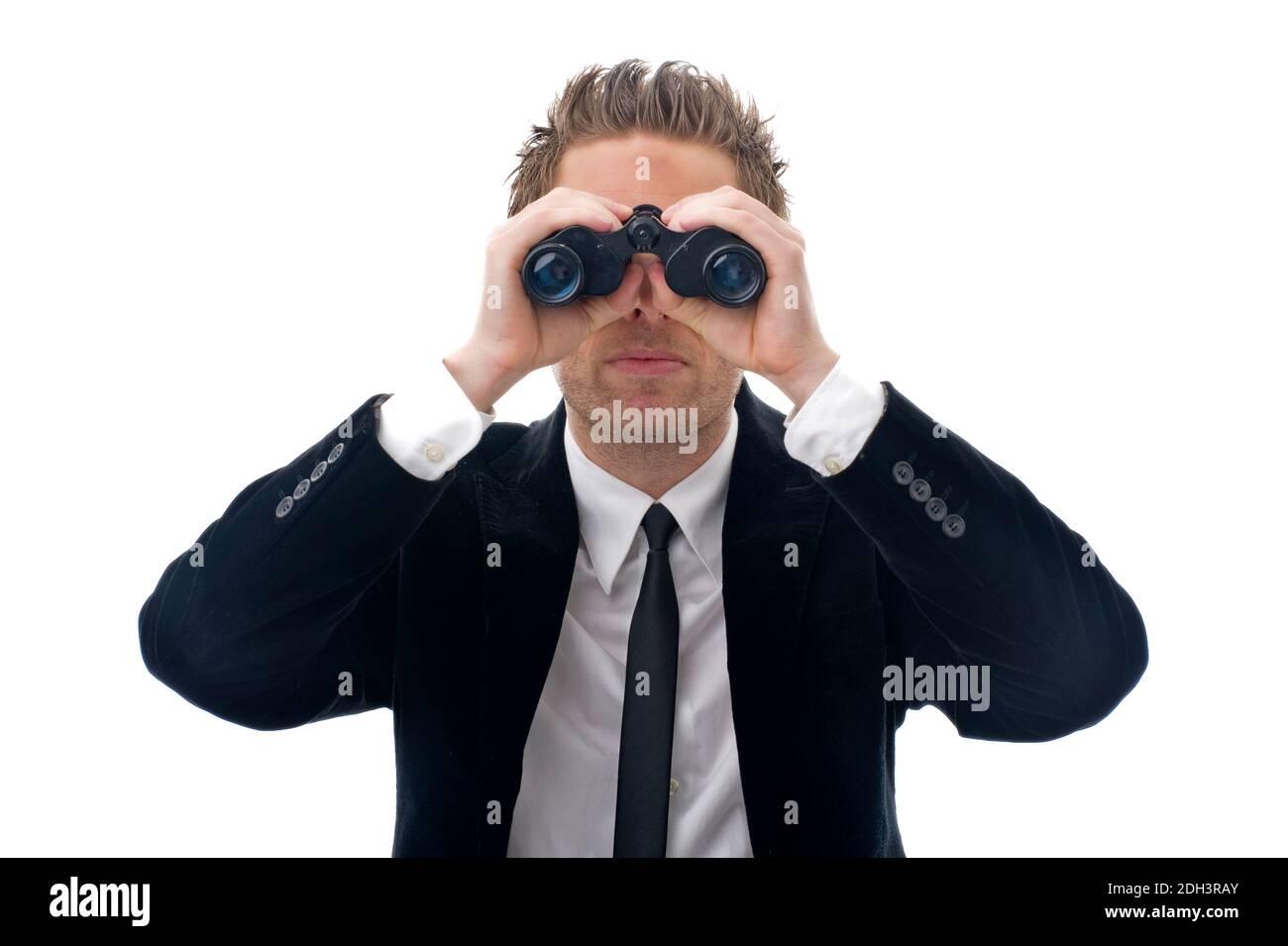 Geschäftsmann schaut durch ein Fernglas, 40 Jahre, MR:Yes Stock Photo