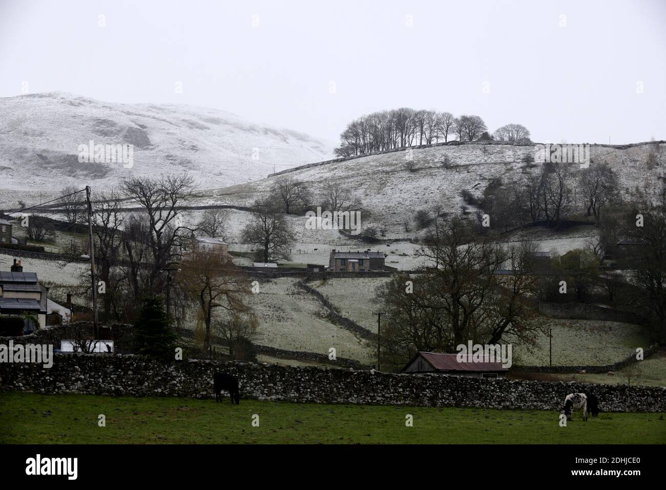 Pictured is a snowy scene in the Yorkshire Dales above Settle. weather snow winter snowing Stock Photo