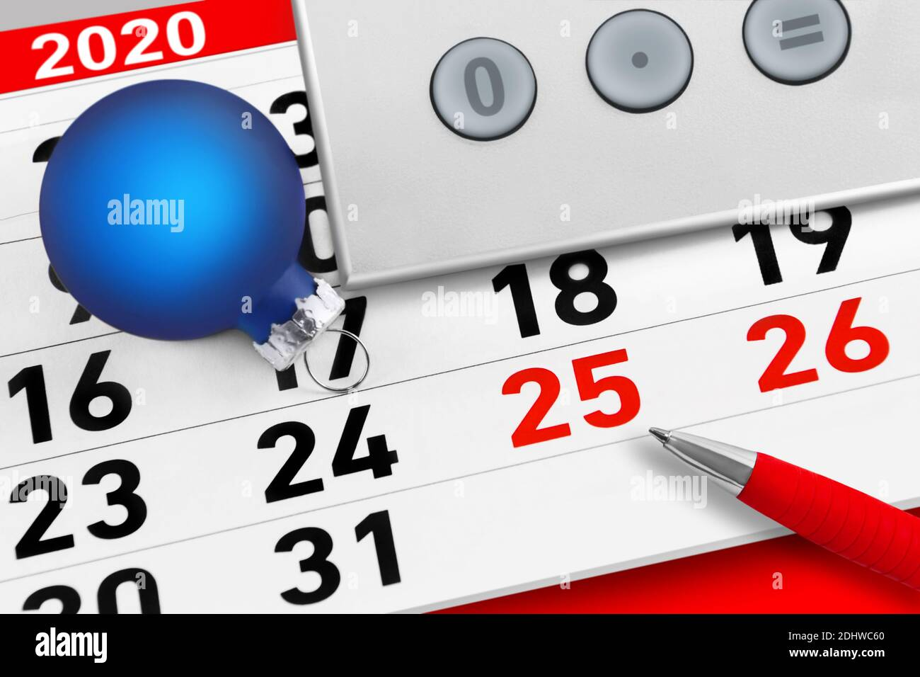 Christmas time 2020 calendar with calculator and red pen Stock Photo
