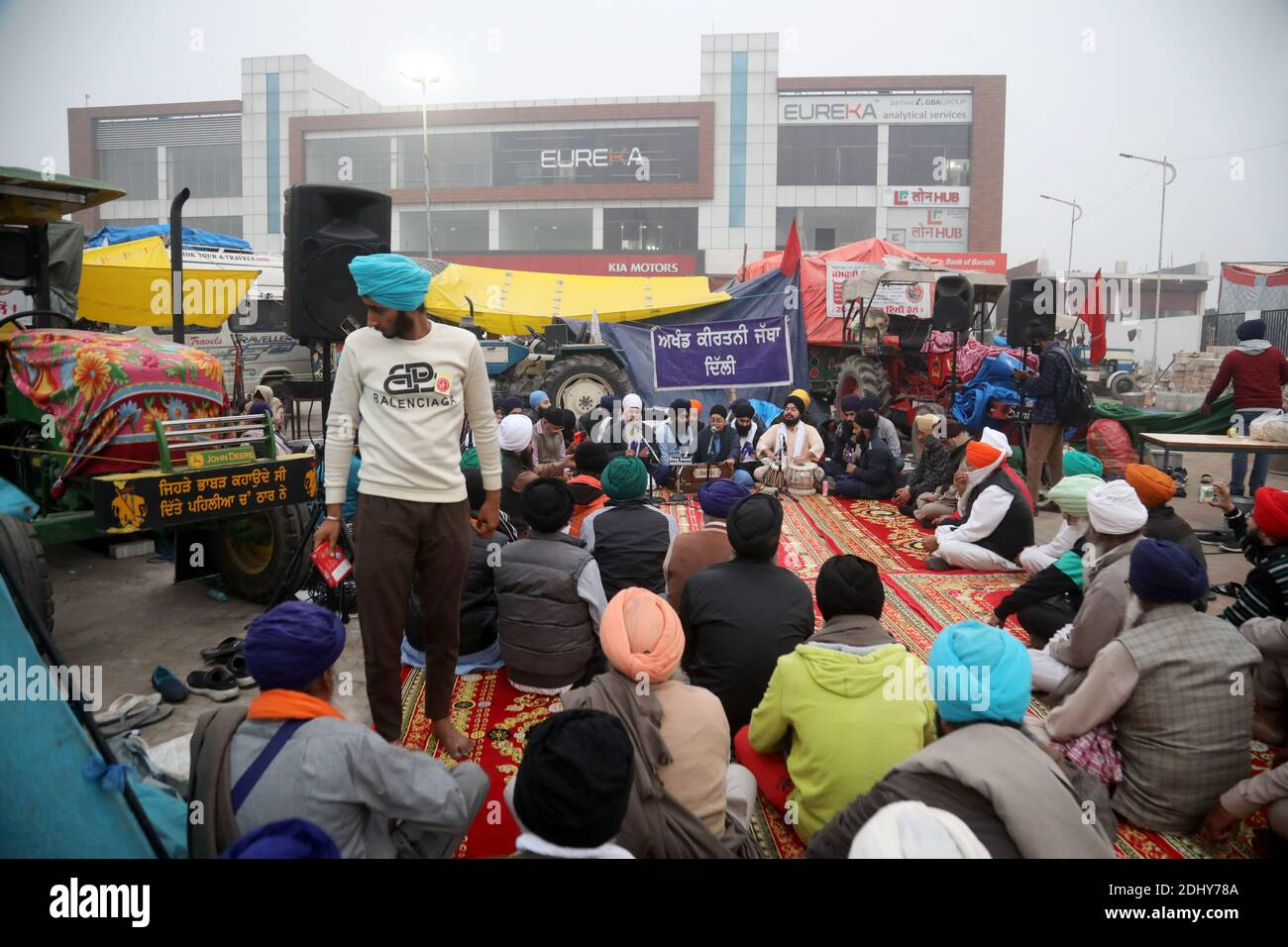 Protesters speaking in Punjabi Shabad Gurbani Kirtan (Holly words) to colleagues during the demonstration.Thousands of farmers from Punjab, Haryana and Uttar Pradesh blocked Singhu border (Delhi-Haryana Highway), Ghazipur border (Delhi-Meerut Highway), Tikri border and Gurugram Border agitating for the 17 days. Against the Centre's new farm reform laws.  Indian Union Minister of Agriculture and Farmers Welfare, Narendra Singh Tomar appeals to farmers to end their protest and work with the government. Stock Photo