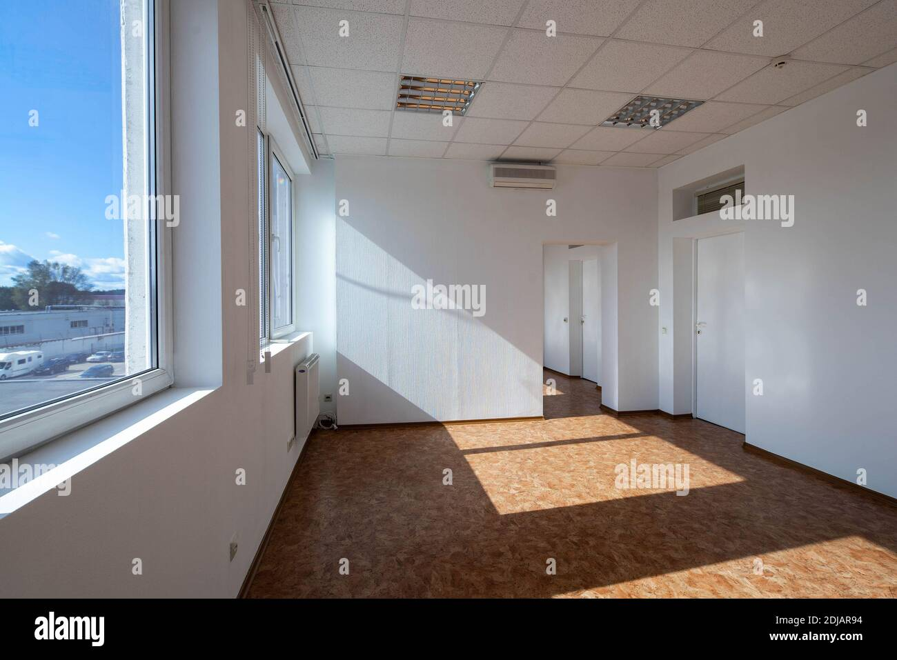 Modern Interior Of Empty Office Rooms White Walls And Door Huge Windows Sunny Day Air Conditioner Stock Photo Alamy