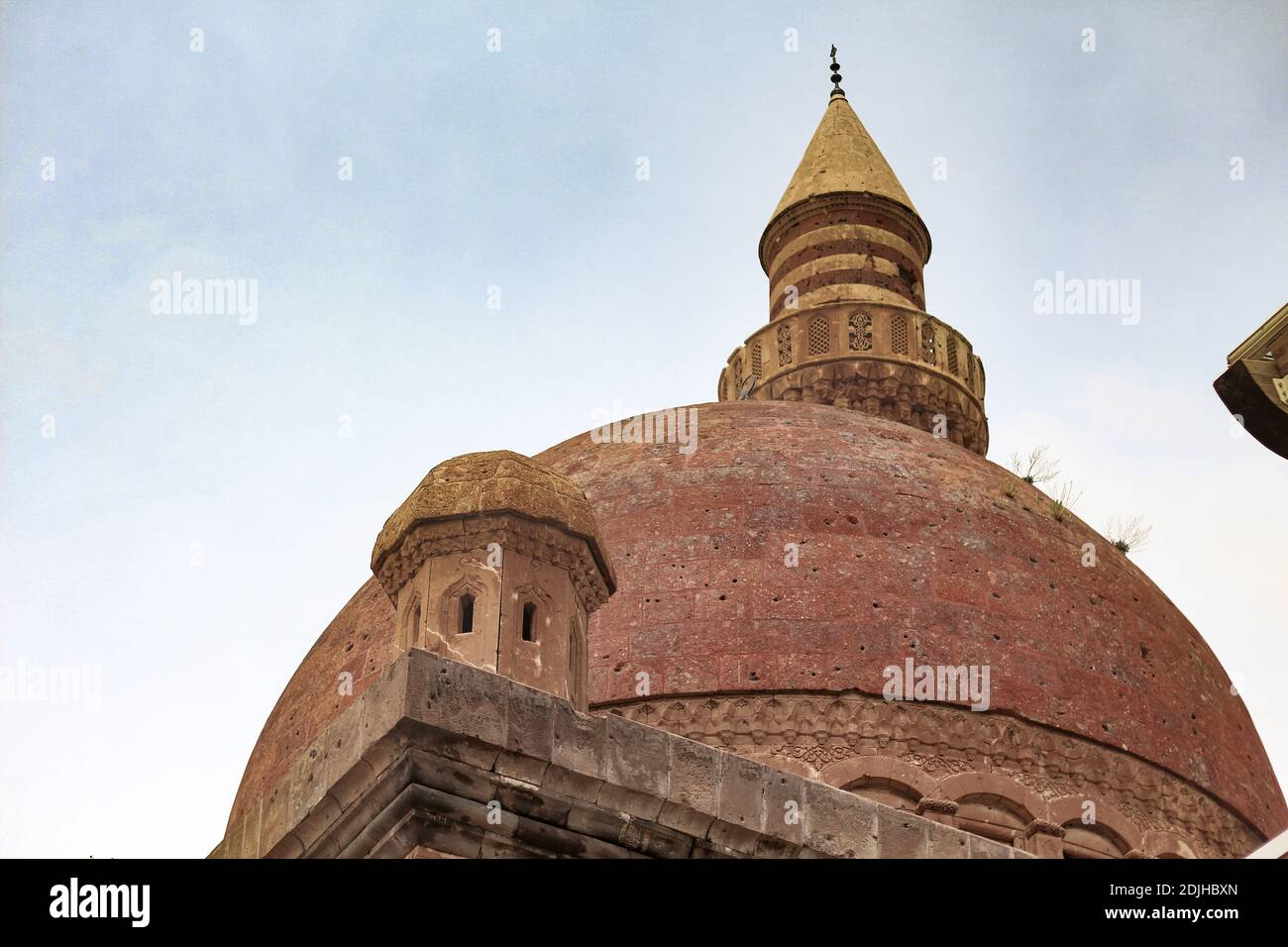 Agri, Turkey - May 2018: The minaret of Ishak Pasha Palace near Dogubayazit in Eastern Turkey. Beautiful brown mosque in the middle east. Different vi Stock Photo