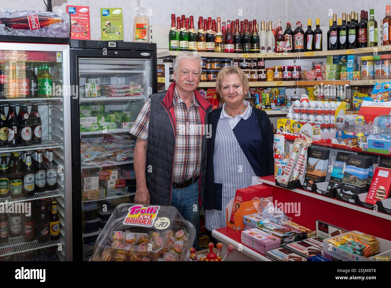 Grocery store owner, husband and wife, 60 - 70 years old, corner shop Stock Photo