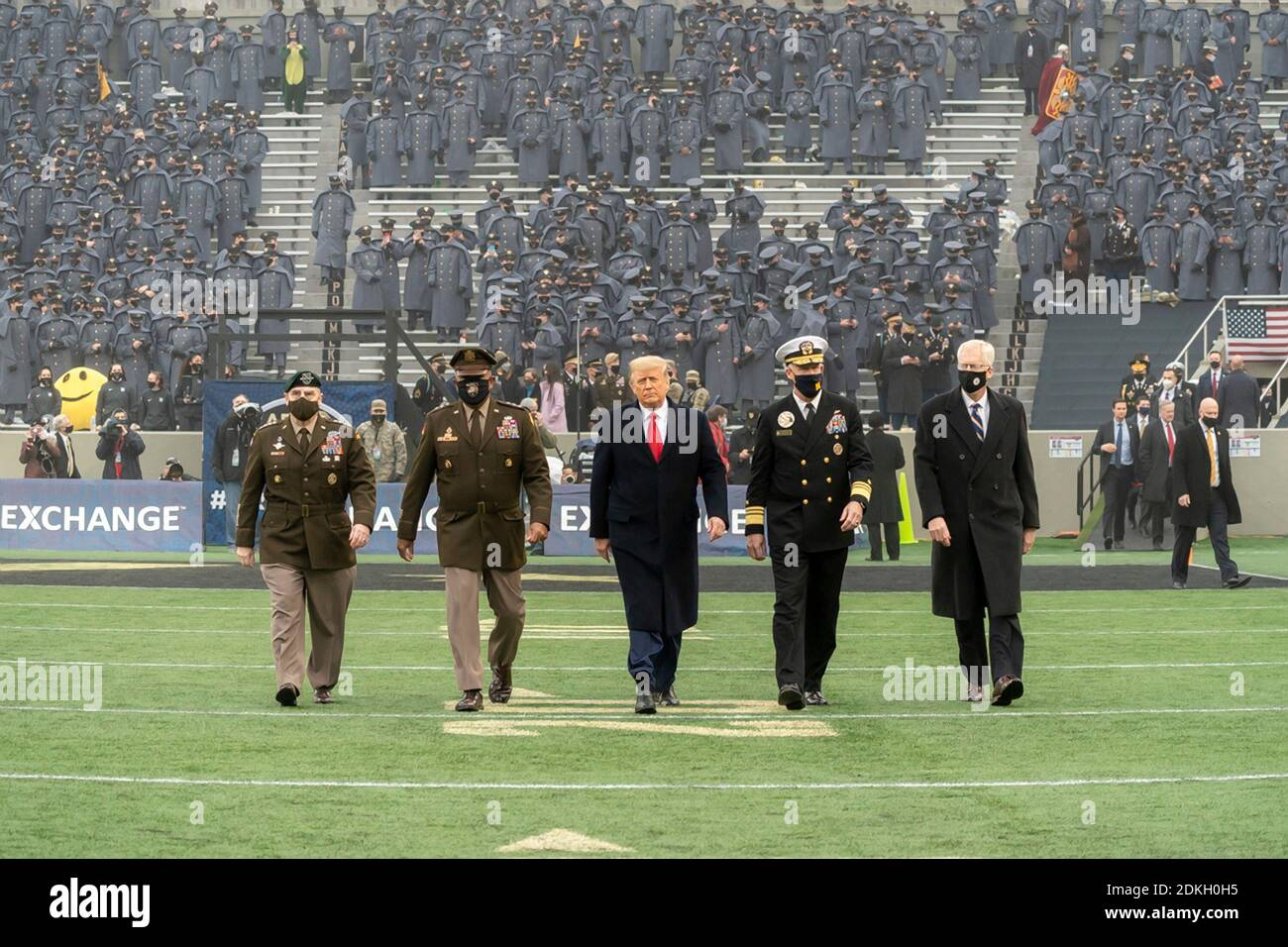 U.S. President Donald Trump walks out for the coin toss to start the 121st Army-Navy football game at Michie Stadium December 12, 2019 in West Point, New York. Walking alongside the president are left to right: Chairman of the Joint Chiefs Gen. Mark Milley, Lt. Gen. Darryl Williams, Superintendent of the U.S. Military Academy, Adm. Sean Buck, Superintendent of the U.S. Naval Academy and Acting Defense Secretary Christopher Miller. Stock Photo