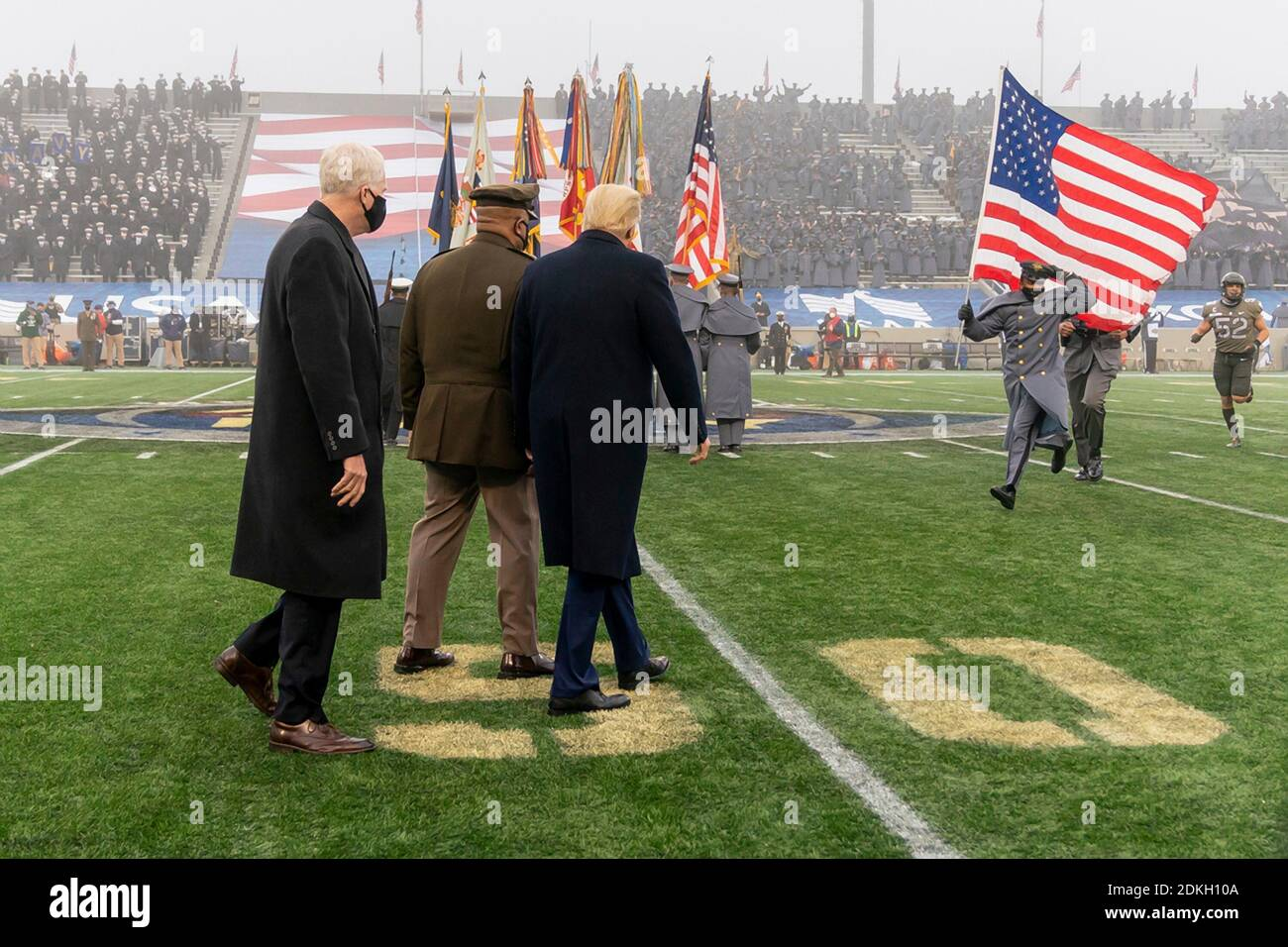U.S. President Donald Trump walks out to the field with Chairman of the Joint Chiefs Gen. Mark Milley, center, and Acting Secretary of Defense Chris Miller, left, at the start the 121st Army-Navy football game at Michie Stadium December 12, 2019 in West Point, New York. The Army Black Knights shutout the Navy Midshipmen 15-0. Stock Photo