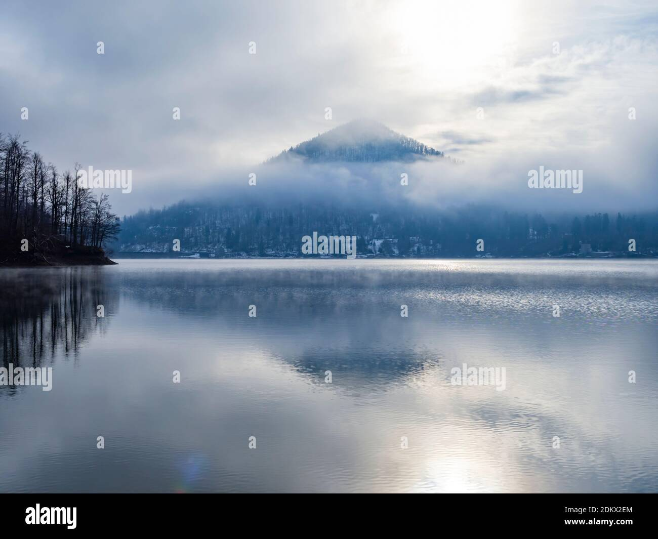 Sunshine morning on lake Lokvarsko jezero near Lokve in Croatia Europe copy space copyspace dreamy atmospheric foggy thin fog remains Stock Photo